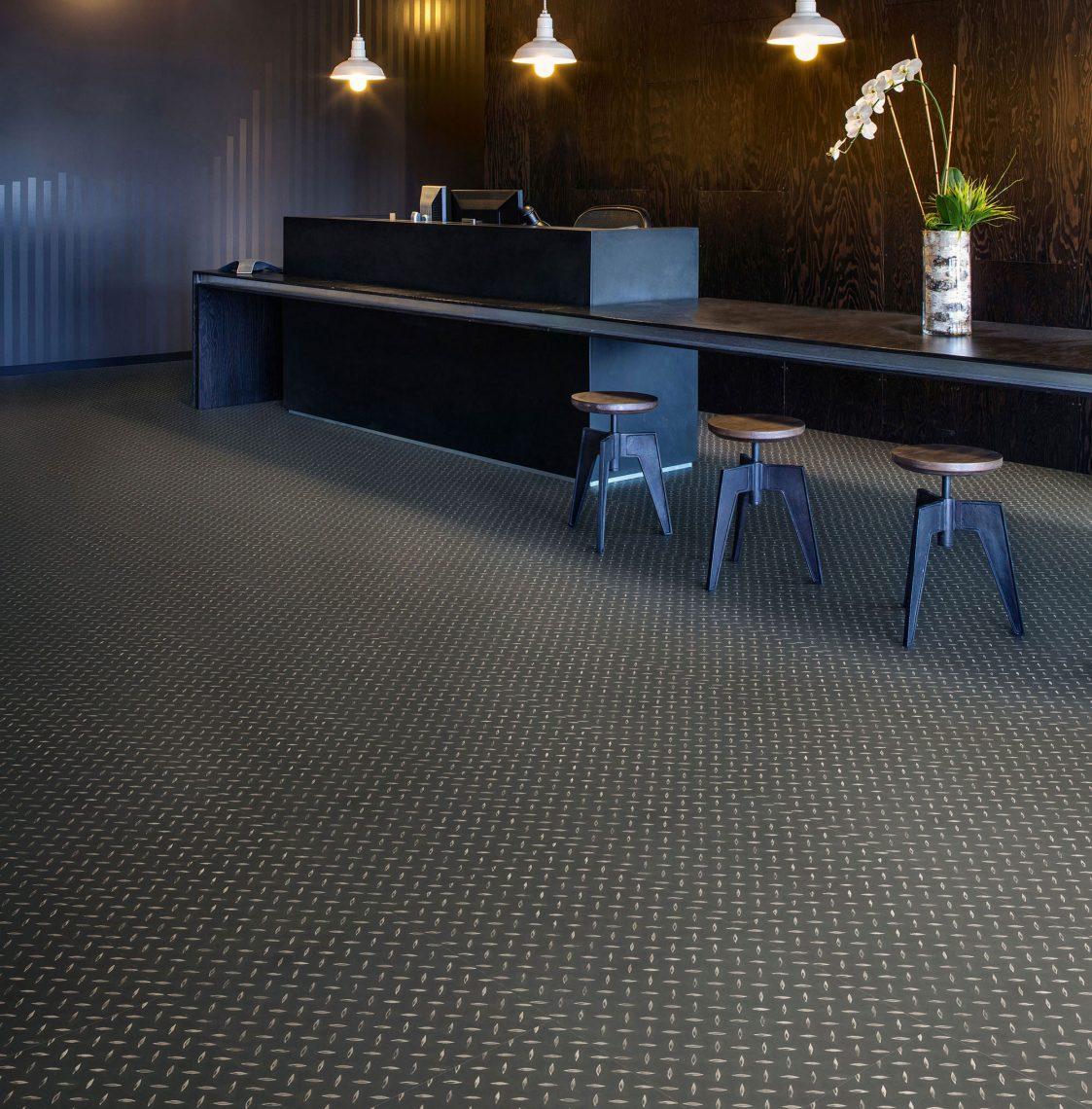 LVT Vinyl Tiles Polyflor Black Treadplate Reception Desk